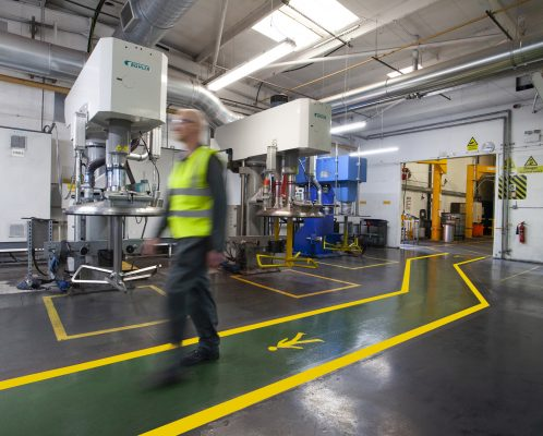 Man walking on warehouse line marking